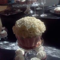Giant Wedding Cupcake This was for a cupcake wedding. I made one large cupcake for the bride and groom to cut into. This was made using ordinary cake pans. The...