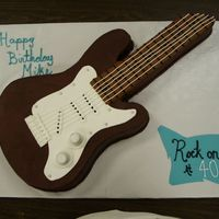Rocking Guitar I did this cake last week upon a request. Just thrilled with the finished product. I used buttercream with the exception of a fondant...
