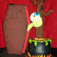 "The Eye And The Cauldron This is a cake I did for my 11yr old daughters halloween birthday. The tree is pvc pipe, halfway up with 5""dummies and the rest rice..."