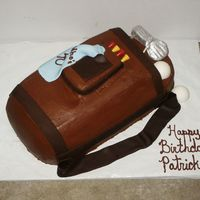 Golf Bag This was actually for a man's 40th Birthday. It was made from a 1/2 sheet cake. Cut to shape. It is covered in Chocolate buttercream...