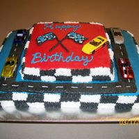 Race Car Birthday Cake My neighbor's little boy had a picture that he just loved and wanted his birthday cake to look like it. He wanted cars on it like the...
