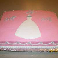 Wedding Gown Bridal Shower Cake 2 layer 11X15 cake with a custard type filling. First time to use Buttercream Dream recipe. Loved it.
