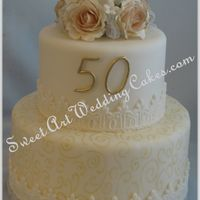 50Th Anniversary Fondant covered with gumpaste roses.