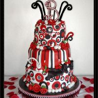 Black And Red Whimsy Circles   The cakes are covered in fondx. The B top is gumpaste with gumpaste pearls and silver dagrees. The rest of the decorations are fondant.