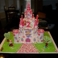 Pink Fairy Castle  Iced in BC with fondant accents. Turrets are fondant and sugar cones. The green ground (grass) is done with colorflow. Trees are gumpaste...