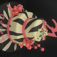Caitie Zebra Cake 10 and 6 inch strawberry cake with buttercream and fondant. Bows, cat, lettering and numbers are gumpaste. Thanks for looking!