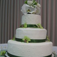 Wedding Cake This was my first wedding cake (other than from the Wilton class). I made it for my brother. It's made of fondant and real orchids. It...