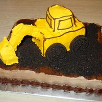 Backhoe   This was my first attempt at a 3D cake. I made it for my nephew's 3rd birthday.