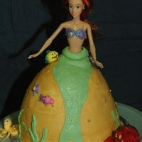 Ariel Cake  Lemon cake with bc frosting, fondant accents and Ariel doll in the middle. This was for my daughter's 5th birthday. She made all of...