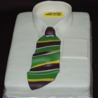 Fathers_Day_Cake.jpg Hubby's father's day cake even though he doesn't eat cakes. Yellow cake with choc. cinnamon filling and fondant tie.