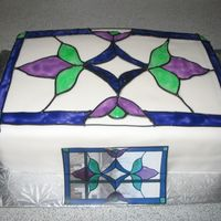 Stained Glass Cake  9x13 chocolate cake covered in fondant with coloured piping gel for the stained glass effect. This was made for a friend at work. The...