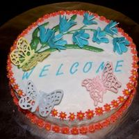 Welcome I made this cake for our new neighbors who just moved in. Bluebells are BC with RI stamens, butterflies are RI too. Thanks for looking!