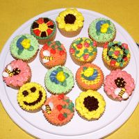 Cupcakes My first cupcakes for FIL's birthday. Yellow cake and bc decorations.