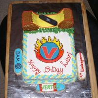 Skateboarding This cake is my husband's idea and he helped me a lot with it. It's a white cale with BC decorations. The skateboard on the ramp...