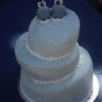 Whimsical Happy Feet Cake This cake is a whimsical cake with hand crafted penguins from Happy Feet.