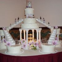 Large Cake/fountain   This was the cake they picked but 2 are fake. They only had 200 at the wedding. Yellow cake and buttercream, silk flowers