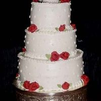 Valentine's Wedding Cake This was my first wedding cake. It was a small wedding and red/valentine's was the theme.Cake was done in Buttercream icing with...