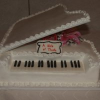Piano Cake Got the idea from someone one here on CC. Lid is cardboard covered in Buttercream, keys are MMF and cake is iced in BC