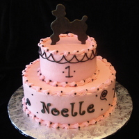 Pink And Black Poodle  Fondant poodle and name, everything else is buttercream over white almond cake. For a friend's one year old daughter. I think it...