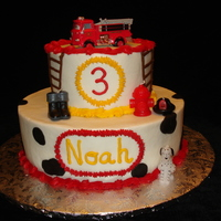 "Fire Truck Birthday  Colorful fire station themed cake. Buttercream and fondant ""spots"" with candle accents + truck on top. The little boy loved it!..."