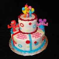 Elmo Birthday Cake 2nd birthday cake for twin girls. I love how it turned out! Thanks to a couple cakes on CC for the inspiration!