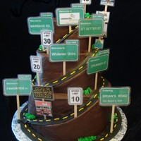 Road Of Life For a 40th birthday! Buttercream iced, fondant road, laminated signs. A topper was put on, but I didn't get a picture. It was a huge...