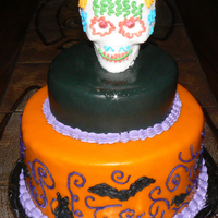 Halloween With Calavera Made this Halloween cake for friends. The Calavera was hand made by a friend, pure sugar. The cake is vanilla with Coconut Cream filling. I...