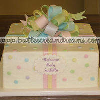Baby Shower Cake Simple buttercream cake with fondant bow and dots.