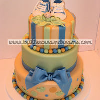 Pea In A Pod Plus Sneakers Pea in a pod themed cake in the client's chosen colors of spring green and cantaloupe, plus a pair of sugarpaste sneakers.