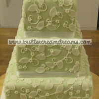 "Sage Green, White Flowers This little 4, 6, & 8"" stacked cake was covered in green fondant and white flowers & leaves. This was for a very small wedding..."
