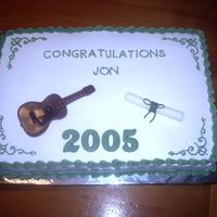 Graduation Cake With Guitar Guitar is molded from candy melts. rolled fondant diploma.