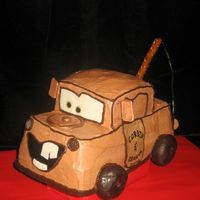 Like Tow-Mater, But Without The Tow...  Here's Mater from the movie Cars. Made with a loaf pan and a 4-inch square trimmed to form the cab. Chocolate buttercream with fondant...