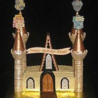 Hogwarts Castle I used the Wilton castle kit and LOTS of luster dust for this castle. The reason the cake is so small is that it was for only four people,...