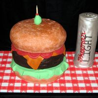 Burger & Beer Can  Fun cake to make! Buns are 9 in. contour, burger is 9 in' round. Fondant lettuce, cheese and tomatoes. Beer can was made by baking in...