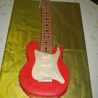Red Guitar Carved from chocolate sheet cakes using cardboard template. Fondant accents. Replica of a Fender Strat, fortunately hubby had one in the...