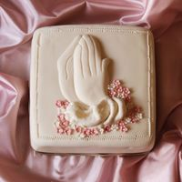 Hands In Prayer Just a small 6 inch cake. Joined hands in prayer done out offondant.