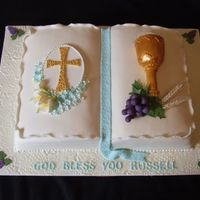 Bible Book pan used. Chalice is made with gumpaste and the flowers