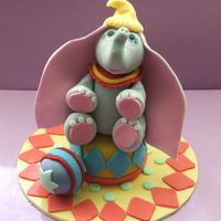 Dumbo!! Dumbo topper made from fondant with added cmc.