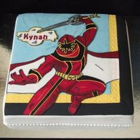 Power Ranger Mystic Force 12 x 12 square cake covered with fondant. Power ranger is donewith fondant cut and paste. Used royal icing for the out lines.