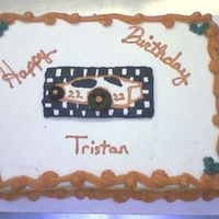 Race Car Chocolate cake with bc frosting. Fbct with cookie wheels.