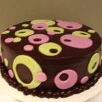 Polka Dots Old Fashion Banana Cake (my grandmother's recipe), filled & iced with dark chocolate ganache. MMF accents.