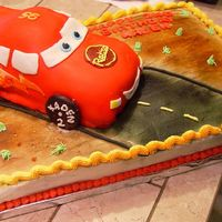 Lightning Mcqueen Birthday Cake I had done fondant and sculpting in class before, but I had not attempted it by myself at home yet. So this is sort of a first for me. I am...
