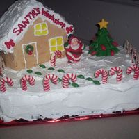 Santas_Workshop.jpg This is my little rendition of the North Pole. I am taking this cake to my business class with me tonight as we are having a party because...