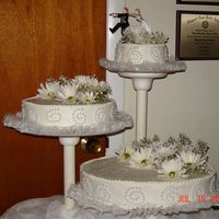 Co-Workers Son Wedding 07/15/06 I did this cake as a last minute favor for a co-worker. I only charged them $65 for the cake because of the reason that her son was getting...