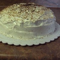 White Cake White cake with egg white whipped icing, very fluffy! On top is shaved dark chocolate.