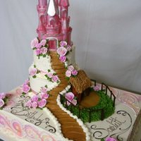 Castle Cake two tier set on full sheet. Buttercream icing. Airbrush work on full sheet.