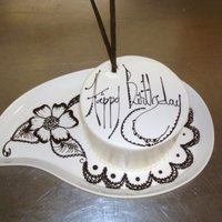 Chocolate Henna small bday cake on paisley plate. Henna design drawn in writing chocolate