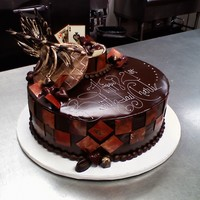 Chocolate Chocolate ganache cake and decor. Chocolate plaques and small chocolate truffle box.