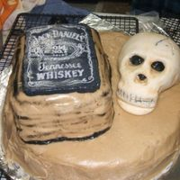 Jack And Skull Made for a man's bday. Devils food cake with caramel icing. Jack Daniels is a FBCT and the skull is fondant painted with luster dust...