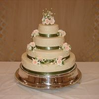 "Peach And Green Wedding Cake Basic white cake. 6"", 10"", 14"", 18"". Gumpaste flowers."